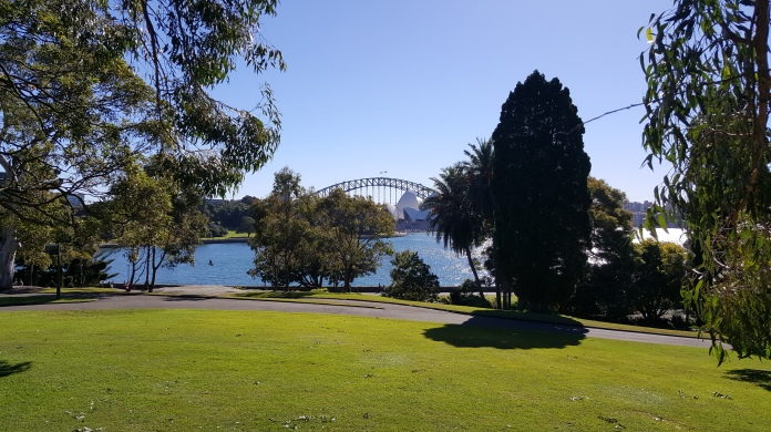 Sydney Botanical Gardens, looking at the Harbour Bridge and Opera House. In 2120 this is The Farm.